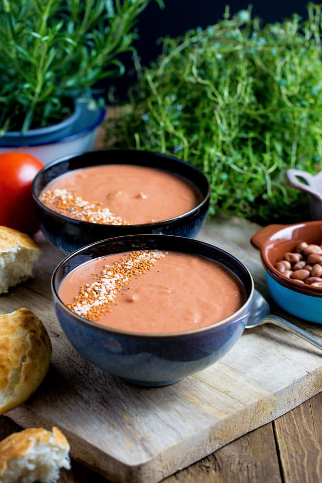 Roasted Garlic and Tomato Soup - aromatic and gently spiced soup, thickened with whole fava beans, finished with balsamic vinegar and coconut sugar to bring out real tomato flavour! #vegan #glutenfree #soup   Recipe on thecookandhim.com