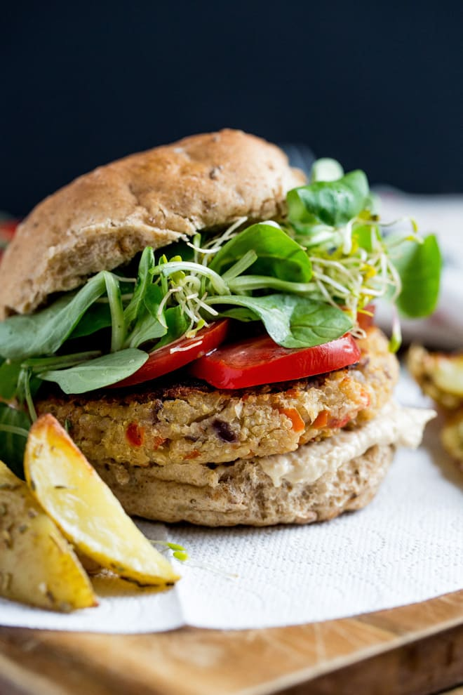 Camembert and Quinoa Burgers - lots of heart healthy veggies, beans, quinoa and vegan cheese go into these super tasty and super easy to make vegan burgers! Recipe on thecookandhim.com