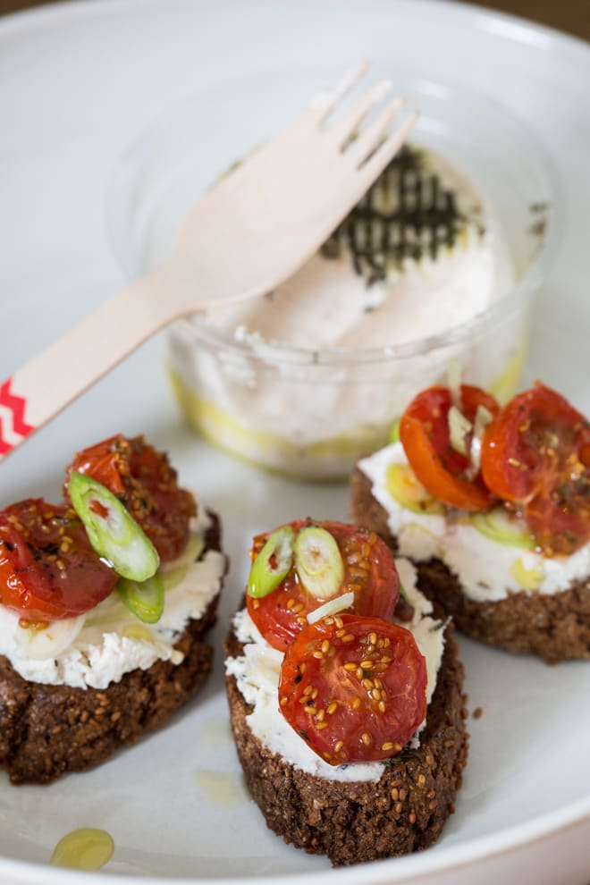 Cherry Tomato and Goat's Cheese Crostini - just a few simple ingredients make these salty, nutty bites sheer indulgent heaven. The New Roots goat's cheese makes them vegan too! thecookandhim.com