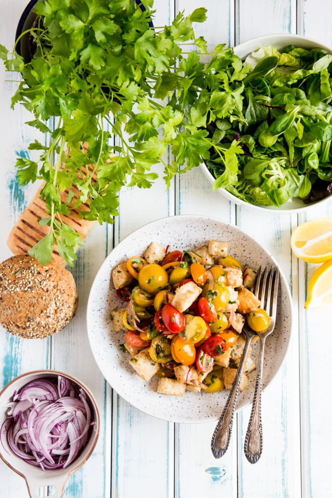 Herb and Lemon Tomato Salad - deliciously light but hearty summer salad, the perfect side or a meal in itself! Full of flavour thanks to the garlic, fresh herbs and zesty lemon | Recipe on thecookandhim.com