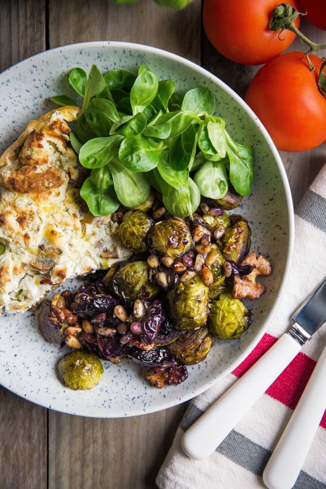 Roasted Sprouts, Grapes and Walnuts - super simple side to accompany so many things! Nutty sprouts, sweet grapes and crunchy walnuts and pinenuts with a dash of herbs, balsamic and mustard. Vegan and gluten free | thecookandhim.com