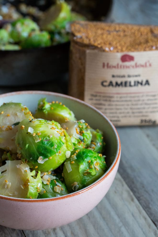 Sprouts with Walnuts and Shallots - fantastic holiday side dish for sprout lovers! Nuttied up with crunchy walnuts and lovely little camelina seeds from Hodmedods | thecookandhim.com