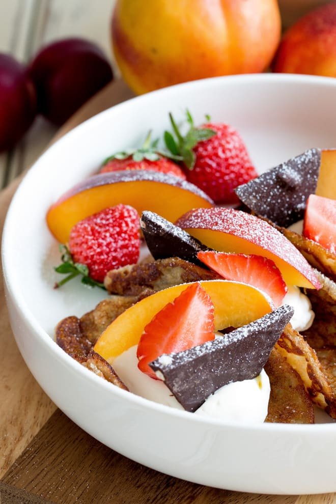 Summer Fruits Pancake Tacos - deliciously light vegan pancakes filled with smooth coconut cream and the best seasonal fruits. The chocolate is literally the icing on the pancake!! Recipe on thecookandhim.com