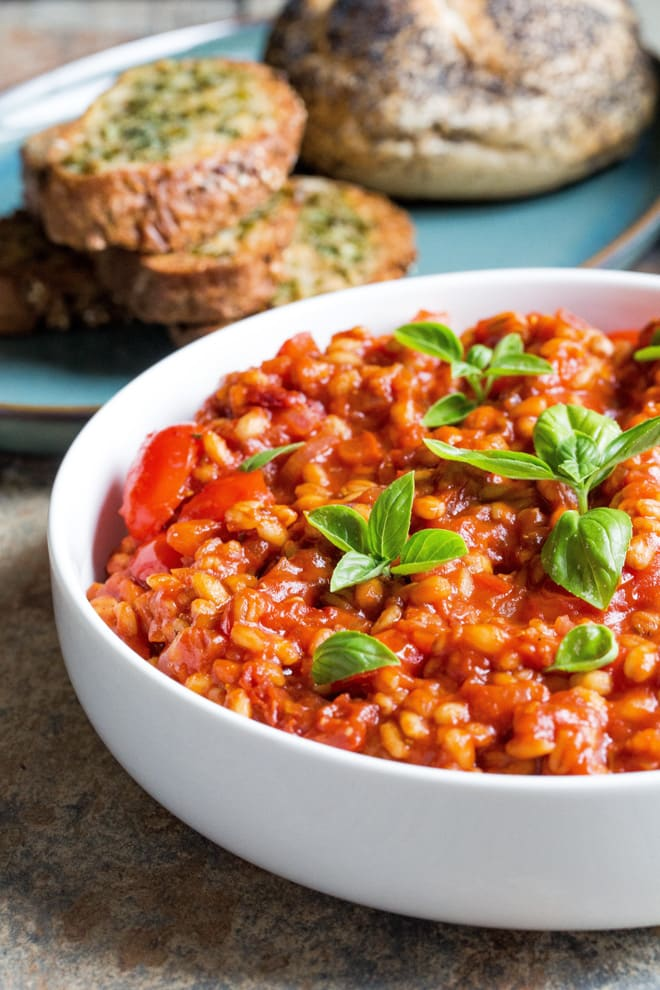 Tomato Pearl Barley Risotto - delicious one pan light but filling summer dish! Crammed with tomato flavour and 'hidden' veggies this is super easy comfort food. Vegan and gluten free. Recipe on thecookandhim.com