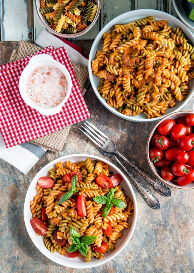 Vegan Pasta Salad with Roasted Tomato Sauce - roasting the tomatoes with veggies, garlic and herbs gives a wonderful depth of flavour to this rich vegan pasta sauce | Recipe on thecookandhim.com