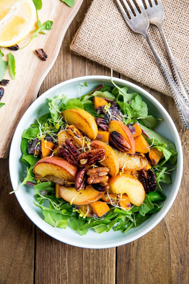 Warm Peach and Sweet Potato Salad with Balsamic Dressing - the perfect summery salad - crisp leaves, salty toasted nuts with warm peaches and sweet potatoes, all bound together with a tangy balsamic dressing! Vegan and Gluten Free | Recipe on thecookandhim.com