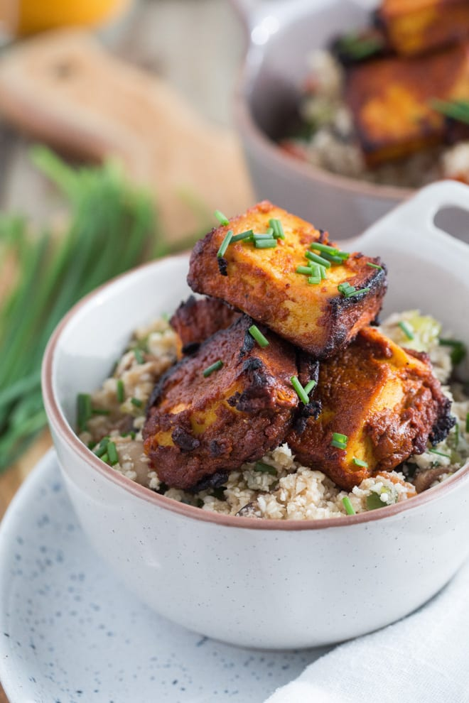 Healthy Indian Takeaway - crisp, succulent tofu marinated in gorgeous warming spices and served with vegetable cauliflower fried rice #veganrecipes #veganmeal #meatfree #healthytakeaway   Recipe on thecookandhim.com