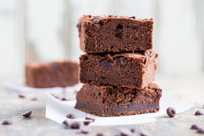 Vegan Brownies - rich, fudgy and bursting with chocolate flavour - everything you want in a brownie! #veganbrownies #veganbaking #veganrecipes   Recipe on thecookandhim.com