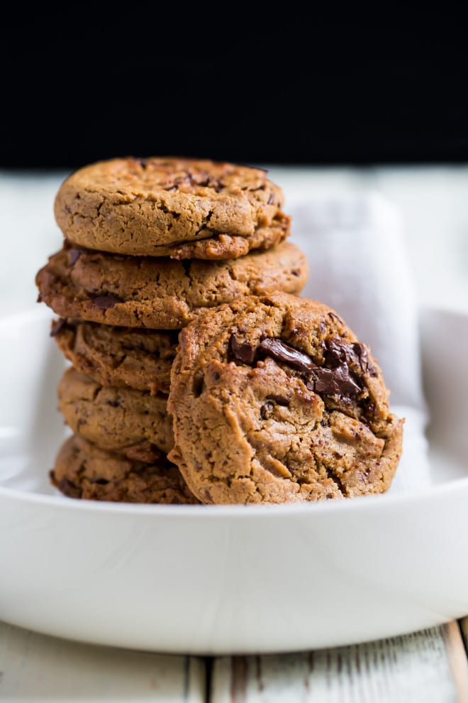 Vegan Cookies - thick, soft cookies loaded with gooey chocolate chunks! No one would ever know they're vegan! #vegancookies #chocolatechipcookies #chocolatechunkcookies | Recipe on thecookandhim.com