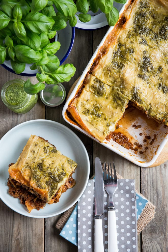 Vegetarian Lasagne Recipe - packed with veggies and lentils in a rich tomato sauce, layered and topped with a vegan cheese and pesto sauce #vegetarianlasagne #vegetablelasagne #veglasagnerecipe #veganrecipes   Recipe on thecookandhim.com