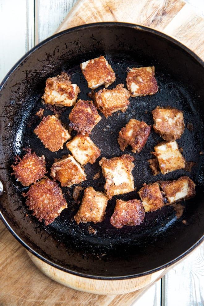 Tofu Stir Fry - crisp tofu marinated in a peanut stir fry sauce with fresh stir fry vegetables and rice noodles! #tofustirfry #cripsytofu #tofurecipes #veganrecipes   Recipe on thecookandhim.com