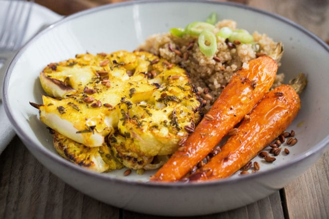 Roast Carrot and Smoked Quinoa Salad with Cauliflower Steaks- herbs, spices, garlic and fresh lemon pack the flavour into the roasted veggies. The smoked quinoa and nutty toasted emmer wheat are wonderful contrasts in flavour and texture! #veganrecipes #veganmeals #quinoa | Recipe on thecookandhim.com