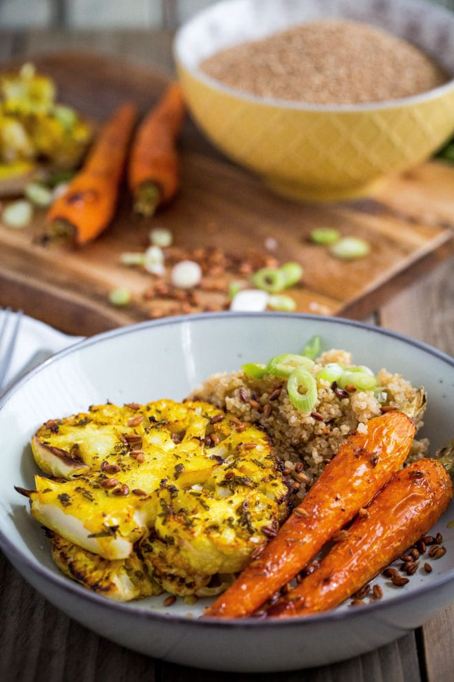 Roast Carrot and Smoked Quinoa Salad with Cauliflower Steaks - herbs, spices, garlic and fresh lemon pack the flavour into the roasted veggies. The smoked quinoa and nutty toasted emmer wheat are wonderful contrasts in flavour and texture! #veganrecipes #veganmeals #quinoa | Recipe on thecookandhim.com