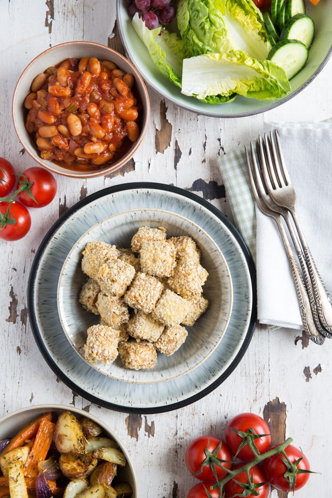 Marinated tofu baked with a deliciously crunchy breadcrumb crust and baked to crispy perfection! #tofu #tofurecipes #howcocooktofu #tofumarinade   Recipe on thecookandhim.com