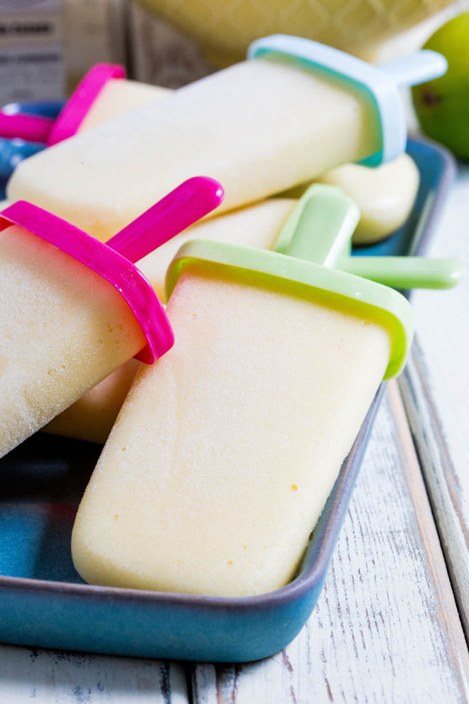 Refreshing non-alcoholic pina colada ice lollies, so easy to make but guaranteed to get you in the mood for summer! #veganrecipes #icelollies #summerrecipes #pinacolada | Recipe on thecookandhim.com