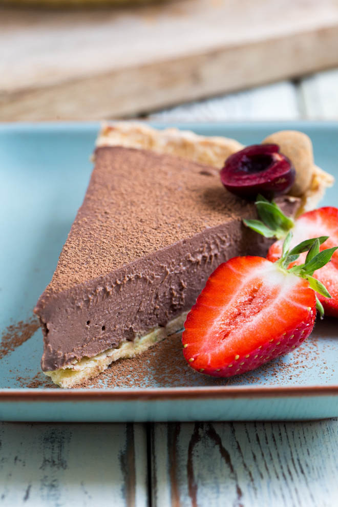 Ultra rich, smooth and creamy this vegan chocolate pie is a complete doddle to make but tastes thoroughly decadent! #veganchocolate #vegandesserts #veganrecipes #silkentofu | Recipe on thecookandhim.com