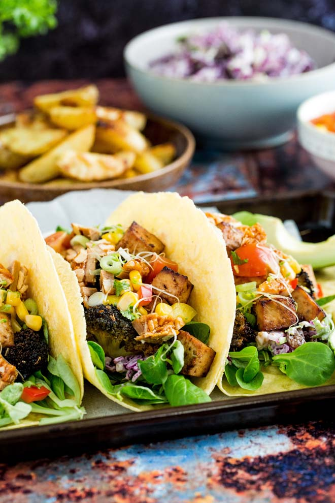 Sweet, smoky flavours of peri peri in these vegan tofu and broccoli tacos, topped with a bright fresh sweetcorn salsa! #periperi #tacos #veganrecipes #vegantacos #meatfree | Recipe on thecookandhim.com