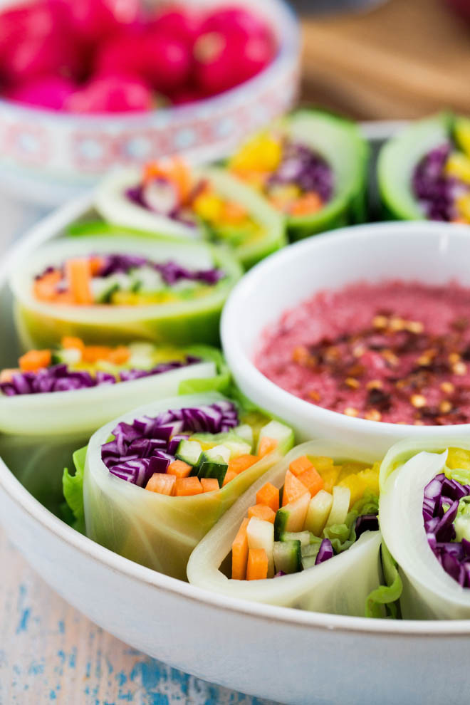 Brighten the darkest day with these rainbow vegetable spring rolls! Colourful veggies wrapped in sweetheart cabbage served with a spiced plum sauce #veganrecipes #rainbowveggies #plumsauce #chinesefood #springrolls #cabbage | Recipe on thecookandhim.com
