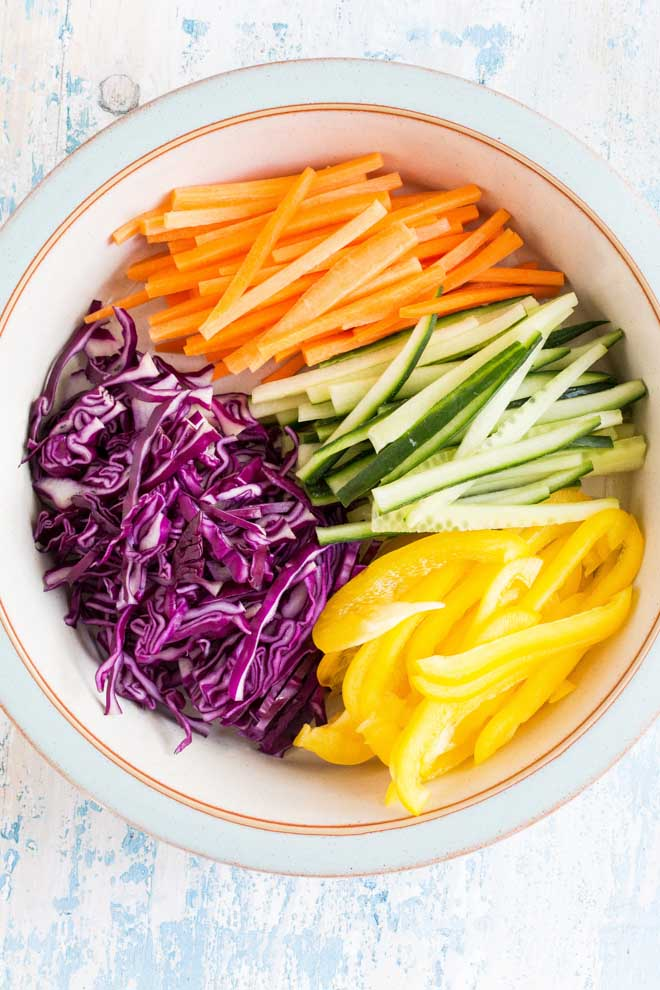 Brighten the darkest day with these rainbow vegetable spring rolls! Colourful veggies wrapped in sweetheart cabbage served with a spiced plum sauce #veganrecipes #rainbowveggies #plumsauce #chinesefood #springrolls #cabbage   Recipe on thecookandhim.com