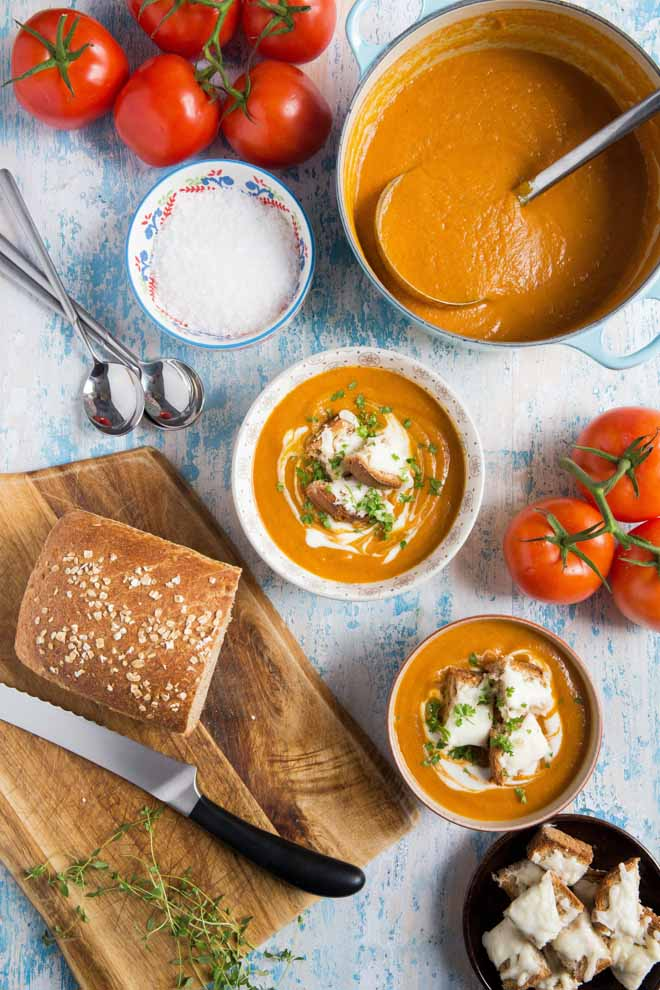 Thick, rich and delicious roasted tomato soup! Packed full of (hidden) roasted veggie flavour and so simple to make - even the vegan cheesy croutons! #tomatosoup #tomatosouprecipe #veganrecipes #vegansoup | Recipe on thecookandhim.com