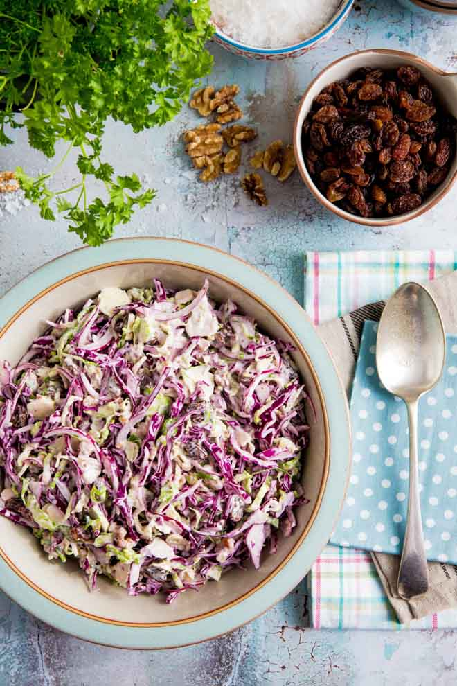Creamy vegan winter slaw made with red cabbage, Brussels sprouts, red onion, crunchy walnuts, jewel like sultanas and a homemade vegan mustard mayonnaise! #veganrecipes #coleslaw #winterslaw #veganmayonnaise #veganmayo   Recipe on thecookandhim.com