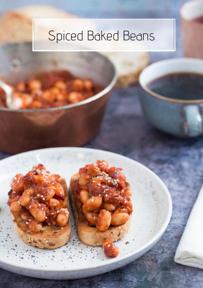 Both sweet and savoury with a spicy kick, these homemade baked beans are made with just a few store cupboard ingredients but are so versatile and absolutely packed with flavour! #bakedbeans #veganrecipes #spicybeans #comfortfood   Recipe on thecookandhim.com