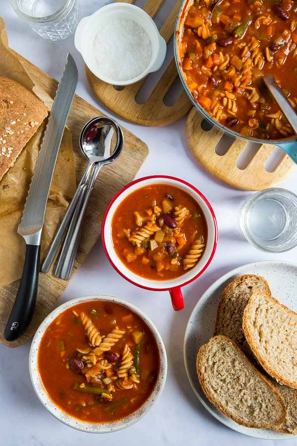 Finding yourself with leftover vegetables? Try this easy and healthy one pot Minestrone Soup full of classic Italian flavours! #minestronesoup #minestrone #vegansoup #veganrecipes #souprecipe #vegetables #onepotmeal | Recipe on thecookandhim.com