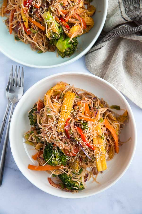 These deliciously easy Sesame Noodles and Veggies are a quick and healthy alternative to take out but taste just as good and can be served hot or cold for an easy weeknight meal or lunch! #sesamenoodles #veggienoodles #coldsesamenoodles #vegetablelowmein #vegetablechowmein | Recipe on thecookandhim.com