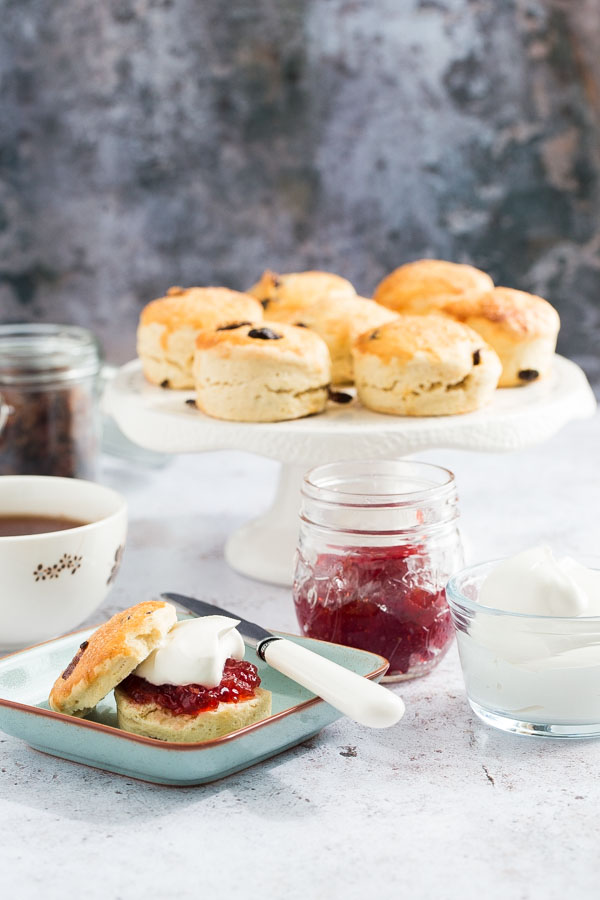 These vegan scones are just as easy and delicious as traditional ones with soft fluffy centres and sweet golden tops! Serve with a super easy homemade jam and vegan cream for the perfect vegan afternoon treat! #veganscones #vegansconerecipe #veganrecipes #veganbaking #afternoontea   Recipe on thecookandhim.com