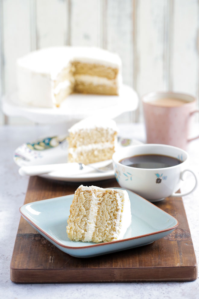 Deliciously light vegan vanilla cake absolutely packed full of sweet vanilla flavour - everything you want from a sponge cake! You'd never know it's vegan either! #vegancake #vanillaextract #vanillacake #aquafaba #veganbirthdaycake #vanillafrosting #vegancakerecipe #egglesscake | Recipe on thecookandhim.com