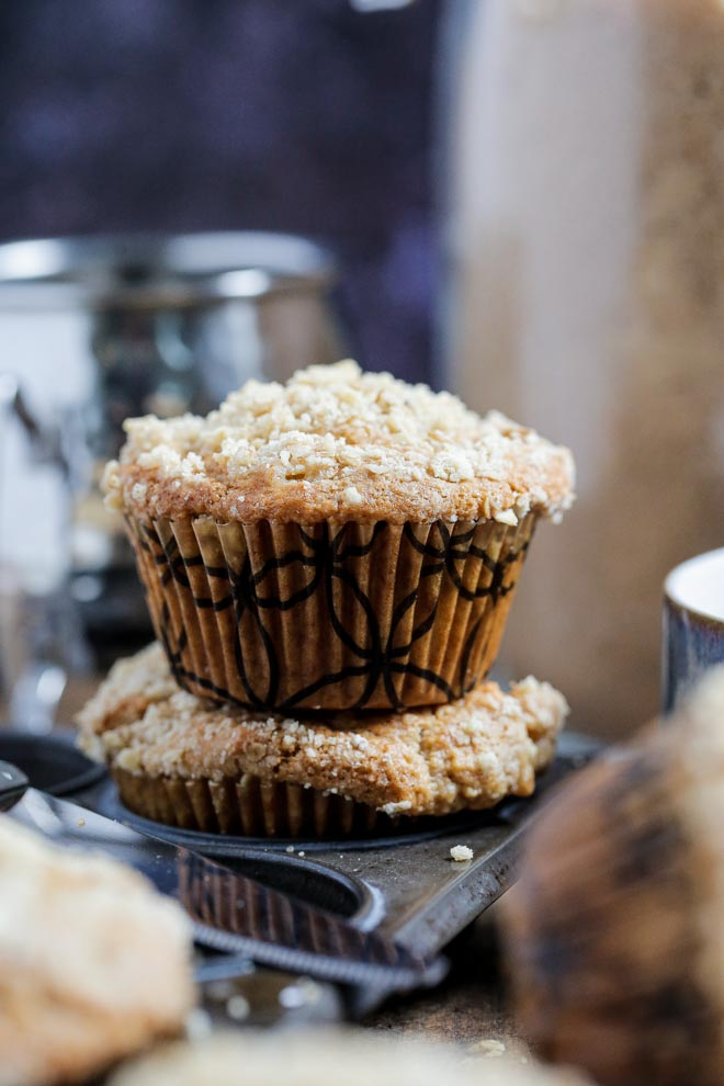 Soft, juicy apples give so much flavour to these caramel apple muffins! Top with cinnamon streusel for the perfect afternoon treat! #veganmuffins #caramel #applemuffins #streusel #muffinrecipe #veganmuffinrecipe #caramelapple | Recipe on thecookandhim.com