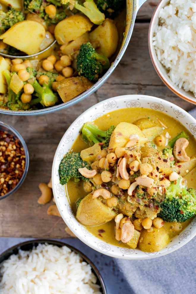 Try this hearty, spicy, easy chickpea and potato curry full of warm, rich flavours for a wholesome midweek meal for the family! Much cheaper and just as quick as takeout! #vegancurry #vegancurryrecipes #chickpeacurryrecipe #chickpeapotatocurryrecipe #potatocurry #vegetablecurry #coconutmilk #garbanzobeans #masala #turmeric | Recipe on thecookandhim.com