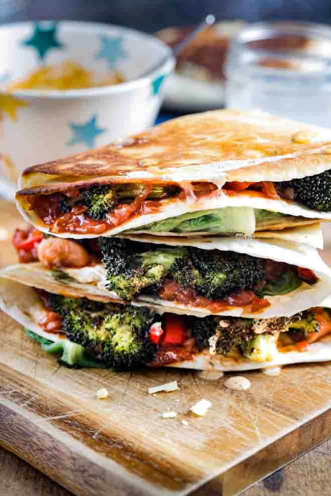 Tonnes of veggies and flavour crammed into folded tortilla wraps. They're crunchy on the outside, warm, cheesy and delicious on the inside! Great for brunch with friends and simple enough for a family weeknight dinner! #vegan #tiktokwraps #foldedwraps #veganrecipes #veganbbq #jackfruitrecipes #plantbased #meatfreemeal | Recipe on thecookandhim.com