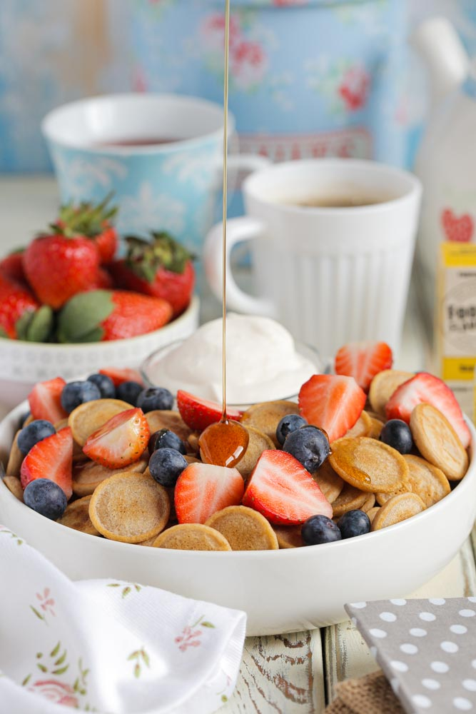 Have fun with your breakfast by making mini pancake cereal! Dinky little pancakes with fresh fruit and whipped cream #pancakes #veganpancakes #pancakecereal #veganbreakfast #veganrecipes #thecookandhim   Recipe on thecookandhim.com