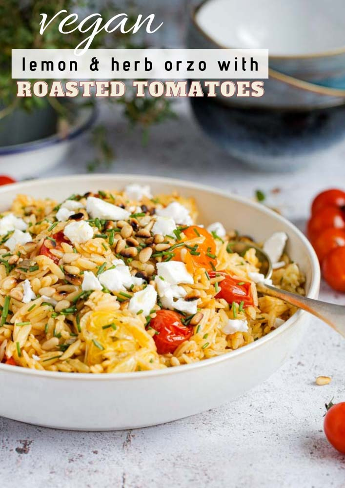 An easy summer dinner with gorgeous pops of flavour in every bite! The lemon and herb orzo is mixed with roasted cherry tomatoes and topped with toasted pine nuts and vegan feta cheese | Recipe on thecookandhim.com | #orzo #pasta #veganpasta #veganmeal #plantbased #vegancheese #dairyfree